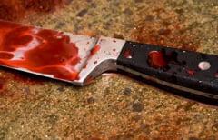 Ucis de partenerul de pahar si abandonat in scara blocului