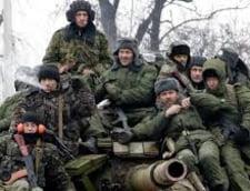 Ucraina, pe un butoi cu pulbere: Separatistii isi fac depozite de arme, armata ii ataca