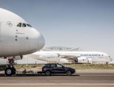 Un Porsche Cayenne diesel a tractat cel mai mare avion de pasageri din lume (Video)
