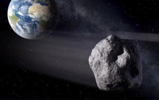 Un asteroid cat un bloc a trecut pe langa Pamant (Video)