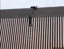 """Un barbat a sarit zidul """"pe care nu te poti catara"""" al lui Trump cu ajutorul unei banale scari (Video)"""
