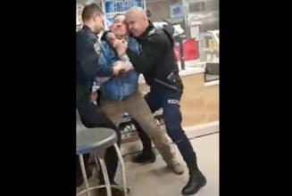 Un barbat din Sibiu a scos cutitul cand i s-a cerut sa poarte masca in magazin. Cum s-au luptat politistii sa-l imobilizeze VIDEO