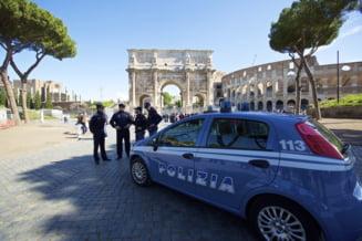 Un bebelus roman a fost impuscat in bratele mamei la Roma