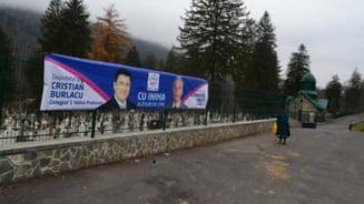Un candidat ARD zambeste de pe gardul cimitirului - E o farsa a USL-ului