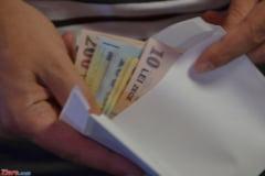 Un consilier de la Senat a luat 10.000 de euro promitand contracte cu statul