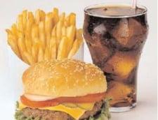 Un europarlamentar roman cere taxa pe fast-food la nivel european