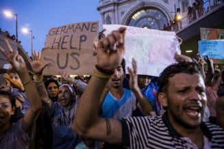 Un ministru neamt cere inasprirea regulilor privind azilul in Germania - ar trebui modificata Constitutia?