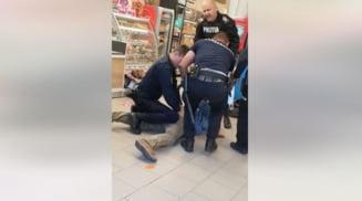 Un politist originar din Slatina, printre oamenii legii care au incatusat un barbat ce a scos un cutit intr-un magazin din Sibiu