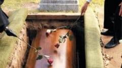 Un preot a lasat mortul langa groapa pentru ca rudele nu au avut 1.100 de lei, tariful lui de inmormantare