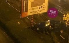 Un sofer mort de beat a distrus un panou publicitar si a vrut sa ii ia la bataie pe cei care voiau sa il ajute VIDEO