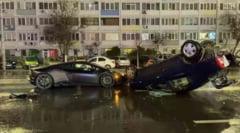 VIDEO Accident spectaculos in Bucuresti. Un Logan a fost rasturnat peste un Lamborghini de sute de mii de euro