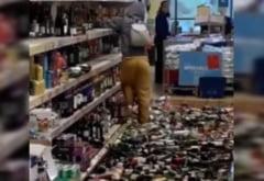 VIDEO Cum a spart o femeie 500 de sticle de bautura dintr-un magazin