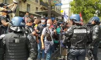 VIDEO Proteste violente la Paris, de Ziua Nationala a Frantei. Manifestantii s-au confruntat cu fortele de ordine