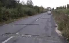 VIDEO Santuri sapate de-a latul soselei chiar de drumari. Zeci de soferi nervosi, dupa si-au rupt masinile in capcana
