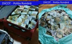 VIDEO Suma uriasa gasita de DIICOT in casa unui traficant de droguri din Bucuresti. Banii erau tinuti intr-o valiza si intr-un sac