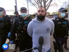 VIDEO Zeci de manifestanti care se opun restrictiilor de pandemie au fost arestati la Melbourne