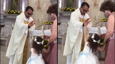 Val de rasete intr-o biserica, dupa ce un copil a interpretat gresit gestul de binecuvantare al preotului VIDEO