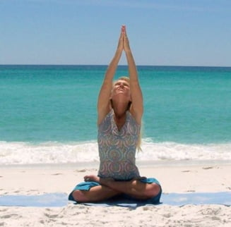 Yoga te scapa de durerile de spate